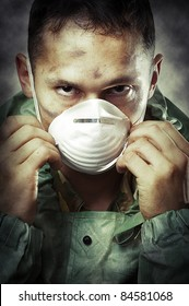 Post apocalypses world halloween concept. Portrait of young Sad man in breathing mask