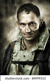 Post apocalypses world halloween concept. Portrait of young Sad handsome military man soldier