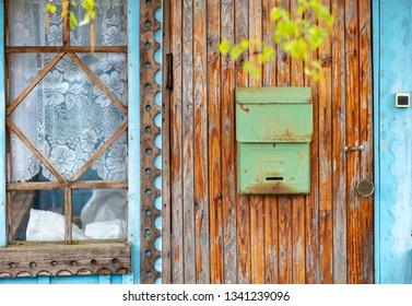Post box on brown wooden door. Russia travel.