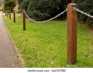 Post and Chain fence down the side of a driveway a popular ornamental feature in gardens