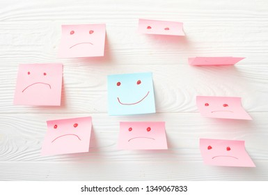 Post face smile and sad emotion.Paper sticky on board