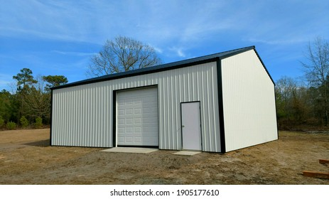 Post frame storage shed perfect for lawnmowers, trailers, ATV's, vehicles, boats, any recreational activities - Shutterstock ID 1905177610