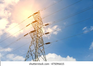 Post High voltage high voltage tower at sunset