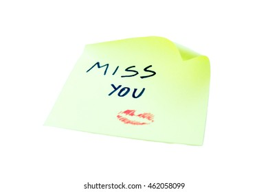 Post it with miss you written on a white background