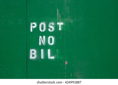 """Post No Bill"" sign on green plywood in New York City."