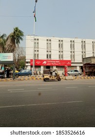 A post office in front of busy road . the Signboard is in Urdu and English - Karachi Pakistan - Nov 2020