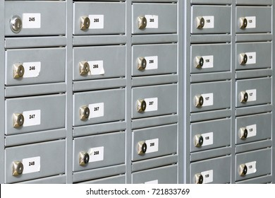 Post office gray boxes. The wall of small metal lockers. PO boxes background.