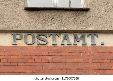 Post office lettering on a building