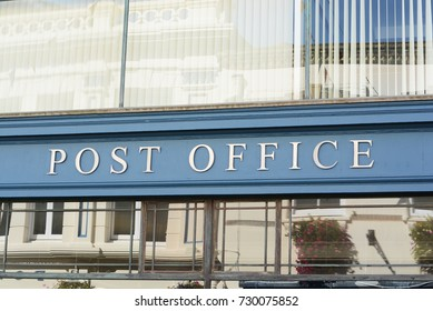 Post Office Sign On The Building Wall