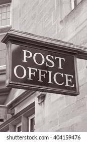 Post Office Sign on Stone Facade in Black and White Sepia Tone
