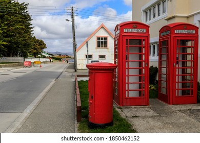 Post Office, symbolic red telephone boxes and red post box, distant sea and mountains, Stanley, Port Stanley, Falkland Islands 12.03.17