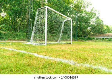 A post or a pair of posts supporting a crossbar and either supporting or extending into the uprights of a goal, as in football.