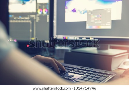 post production - man doing photo and video editing on computer