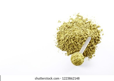 Post workout plant based muscle recovery hemp protein for vegans, bodybuilders and athletes. Healthy dry powder supplement, fitness food, omega 3 & 6 rich. Background, copy space, close up.