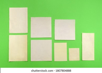 Postage stamps on green background