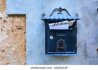 Postal box with letters