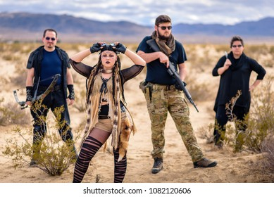 In a post-apocalyptic desert wasteland, a Queen of the Apocalypse leads her militia against the enemy. Armed to the teeth, who will win? Post apocalyptic themed and shot in the California desert