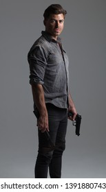 Post-Apocalyptic / Dystopian, Disaster Action Hero – Attractive Caucasian Male with Brown Hair, holding gun and axe
