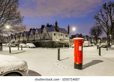 Postbox in snow in London suburb, Chiswick, UK