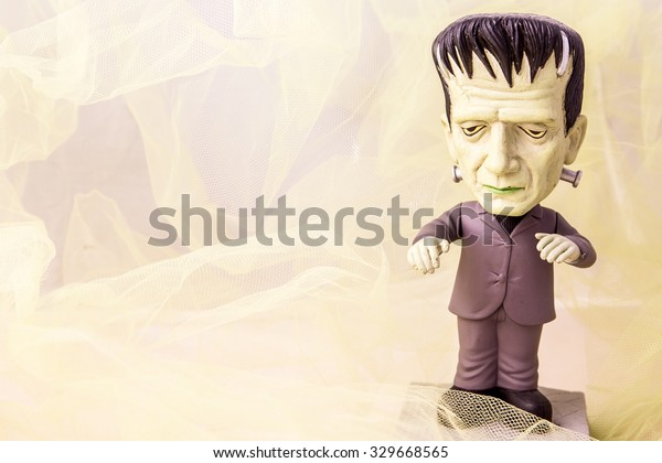 Postcard or background with a doll of Frankenstein,vintage colors.