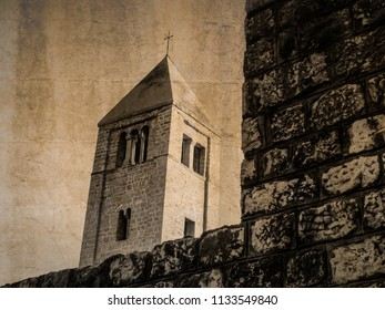 Postcard of the bell tower of St. Andrew's church at Rab, Croatia, in sepia