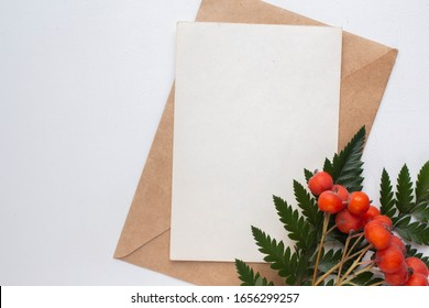 postcard mockup with rowan and leaves