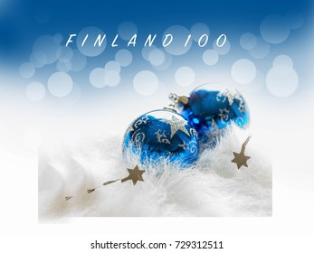 Postcard with name Finland 100. 100 years of independence Finland celebrates in 2017. Blue Christmas baubles on white fur with blue sparkling background.Festive winter and flag color concept.6.12.2017