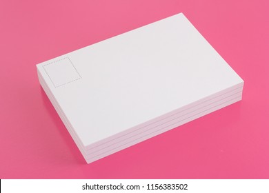 Postcard on the pink floor with copy space area.