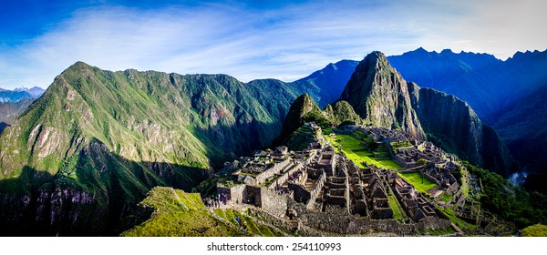 Postcard from Peru - Travel South America, Morning view at Machu Picchu with great sunrise light coming from above the mountains