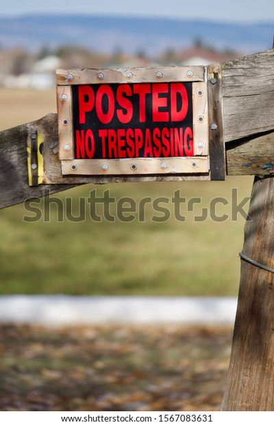 """A """"Posted No Trespassing"""" sign hangs on an old fence post in eastern Washington state."""