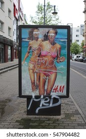 Poster of a fashion store with graffiti all over it, claiming the advert is sexist.