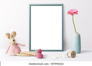 Poster frame mockup, front view, with bunny toy, vase of flowers and blank space on white background.