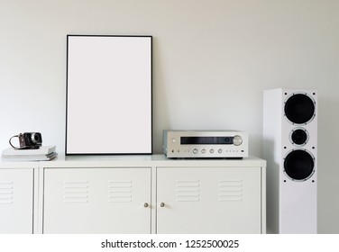 Poster Frame Mockup in white modern interior. Modern audio stereo system with white speakers on bureau in modern interior.
