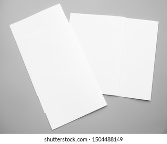 Poster mock-ups paper, white paper isolated on gray background, Blank portrait A4. brochure magazine isolated on gray, can use banners products business texture background for your.