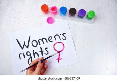 "The poster is painted in colors by the Equolity women""s day. Poster Women""s rights on white background."