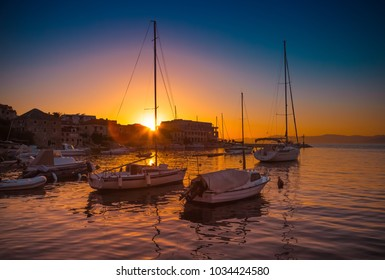 POSTIRA, CROATIA - JULY 12, 2017: Lots of fancy yachts at the sunset in the harbor of a small town Postira - Croatia, Brac island
