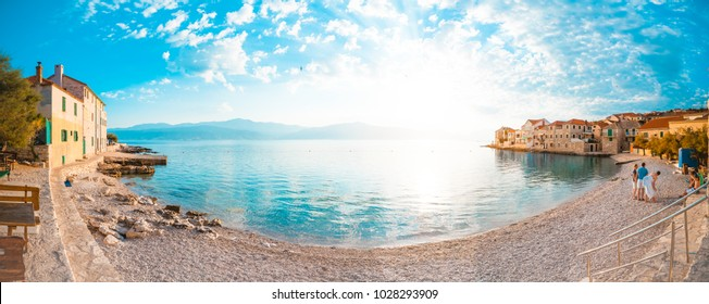 POSTIRA, CROATIA - JULY 13, 2017: Panoramic view on beautiful beach of town Postira - Croatia, Brac island