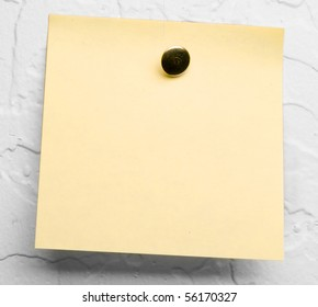 Post-it note on white textured wall