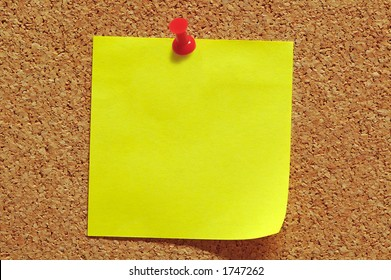 Post-It Note and Push Pin on Cork Noticeboard