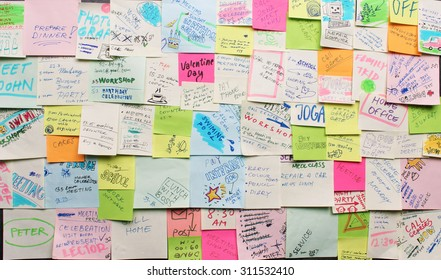 Post-it notes arranged on the wall - busy concept