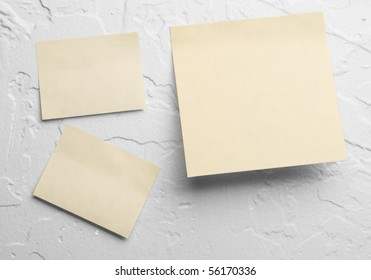 Post-it notes on white textured wall