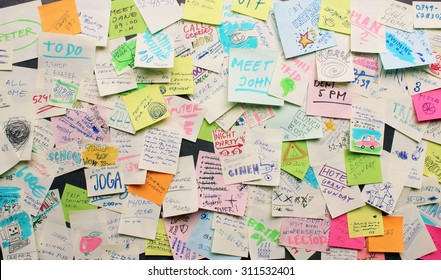 Post-it notes sticked chaotically on the wall - busy concept