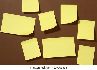 A lot of Post-it on brown background