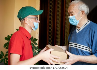 postman brings the package to the elderly person