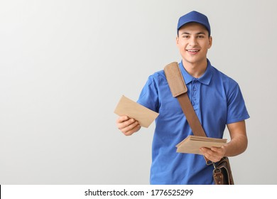 Postman with letters on light background