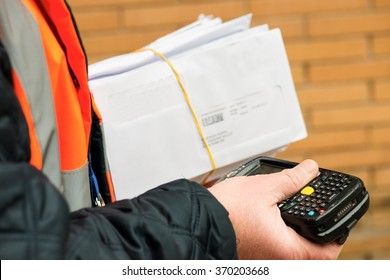 postman scanning mails before delivering them