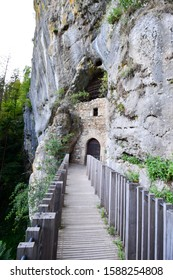 POSTOJNA, SLOVENIA - AUGUST 15, 2019: Cave at Predjama castle which is a Renaissance castle built within a cave mouth in south-central Slovenia, in the historical region of Inner Carniola.