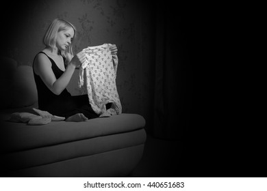 postpartum women's depression. the cleaning in the house. upset woman. wash diapers.