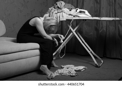 postpartum women's depression. the cleaning in the house. upset woman. wash diapers