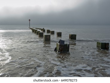 Posts set out to assist in the breaking of waves before they reach the shore and erode the beach.